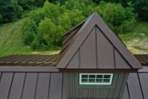 metal roof install with flashing and edging over chimney