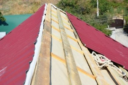new metal roof installed over old roof